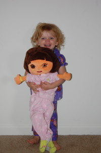 Did I mention that I have to change Dora's pull up and dress her in Molly's pajamas?