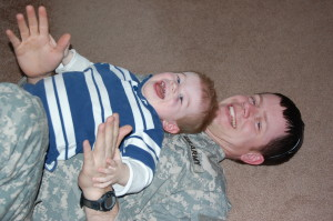 March 2009 Playing with daddy and all smiles.  Morgan was home for 2 weeks of R&R during his second deployment.