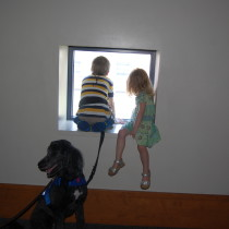 Brian taking a break at the McWane Science Center.  Molly had to check out his quiet little nook too.