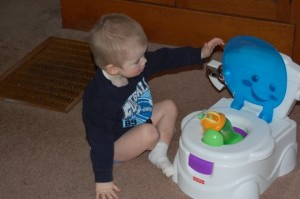Putting his sippy cup in the potty, ha!
