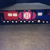 Brian's perfectly designed train on his bed frame.